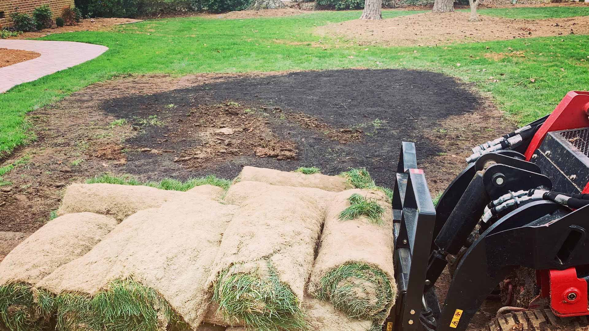 This homeowner is having sod installed to revitalize a large dead patch in their front yard.