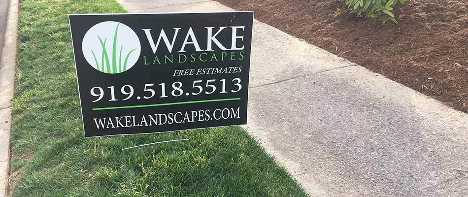 Apex home with Wake Landscapes sign in their front yard.