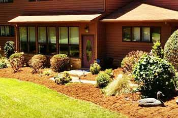Landscape bed that has been designed and installed for this homeowner in Apex.