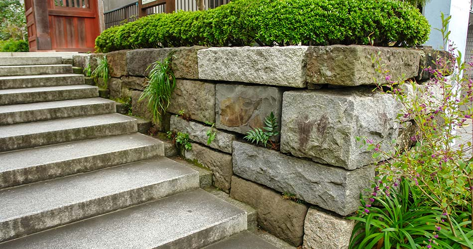 Cary property with pave stones and a retaining wall